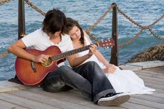romantic couple with guitar stock image