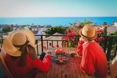 Romantic couple having breakfast on balcony terrace with sea view. Young couple having breakfast on balcony terrace with sea view stock photography