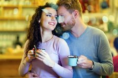 Romantic couple having date in coffee shop Royalty Free Stock Photos