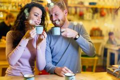 Romantic couple having date in coffee shop Royalty Free Stock Images