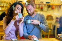Romantic couple having date in coffee shop Stock Photos