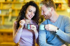 Romantic couple having date in coffee shop stock images