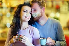 Romantic couple having date in coffee shop royalty free stock image