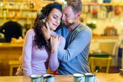 Romantic couple having date in coffee shop. Romantic happy couple having date in coffee shop royalty free stock photography