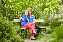 Romantic couple having a date in a garden Stock Photography