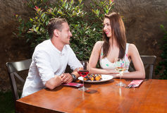 Romantic couple having desert outside on terrace Royalty Free Stock Photos