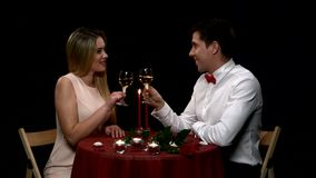 Romantic couple having dinner, clinking glasses stock footage