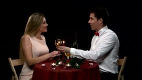 Romantic couple having dinner, clinking glasses stock video
