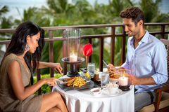 Romantic couple having dinner stock images