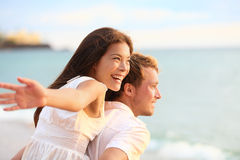 Romantic couple having fun on beach Stock Image