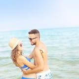 Romantic couple having fun at the beach Royalty Free Stock Image
