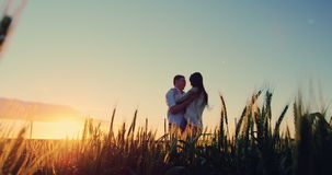 Romantic couple having fun in field stock footage