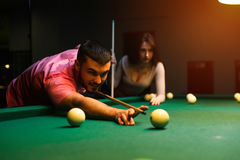 Romantic couple having fun playing billiard game Royalty Free Stock Photos