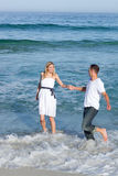 Romantic couple having fun at the seaside Royalty Free Stock Photo