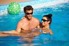 Romantic couple having fun in swimming pool Royalty Free Stock Images