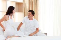 Romantic couple having fun on their bed Royalty Free Stock Photography