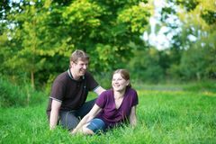 Romantic couple having a picnic outdoors Stock Photos