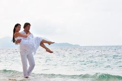 Romantic couple having a walking on the sea shore Royalty Free Stock Photography