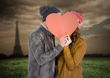 Romantic couple hiding their face behind heart Stock Photo