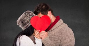 Romantic couple hiding their face behind heart Stock Image
