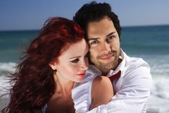 Romantic couple holding each other at the beach Royalty Free Stock Photos