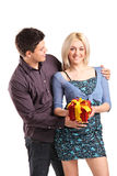 A romantic couple holding a gift Royalty Free Stock Photography