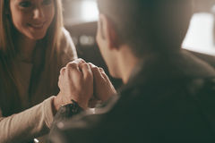 Romantic couple holding hands at the bar. Staring at each others eyes Royalty Free Stock Images