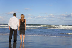 Romantic Couple Holding Hands On A Beach Royalty Free Stock Images