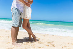 Romantic couple holding hands on the beach. Stock Images