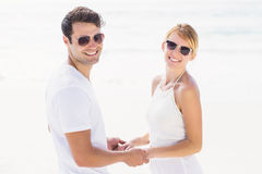 Romantic couple holding hands on the beach Royalty Free Stock Photography