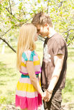 Romantic couple holding hands and coming closer Stock Photography