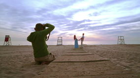 Romantic couple holding hands. Love story photo shooting. stock video footage