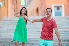 Romantic couple holding hands on Steps in Rome enjoy italian holidays. Happy lovers walking on the travel landmark. Happy tourist couple, men and women traveling royalty free stock photography