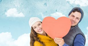 Romantic couple holding heart against sky background Stock Photos
