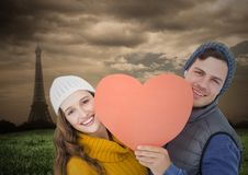 Romantic couple holding heart against wooden background Stock Images
