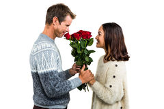 Romantic couple holding red roses Royalty Free Stock Photos