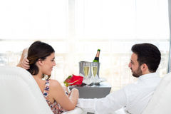 Romantic couple in hotel room celebrating with champagne. Close up portrait of young honeymoon couple in hotel suite celebrating with champagne stock image