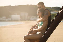 Romantic couple in hug watching sunrise/ sunset together.Young man and woman in love Stock Images