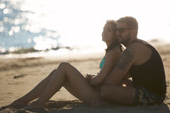 Romantic couple in hug watching sunrise/ sunset together.Young man and woman in love Stock Photos