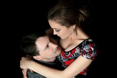 Romantic couple hugging. Man and woman hugging. Romantic couple on a black background Royalty Free Stock Photography
