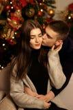 Romantic couple hugging in christmas interior Stock Photos