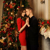 Romantic couple hugging in christmas interior royalty free stock photos
