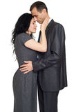 Romantic couple hugging, dressed in black suit, isolated white Stock Image
