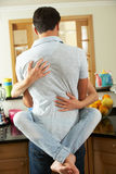 Romantic Couple Hugging In Kitchen Royalty Free Stock Photo