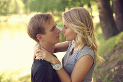 Romantic couple hugging in park Stock Images