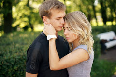 Romantic couple hugging in park on a summer day. Blonde tender girl hugging her boyfriend Stock Images