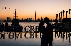 Romantic couple hugging at sunset in Dubai stock photos