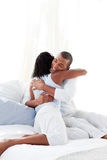 Romantic couple hugging on their bed Royalty Free Stock Photo
