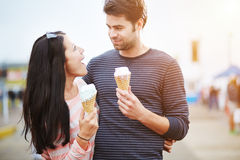 Romantic couple with ice cream at amusement park stock photography