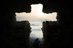Romantic couple inside cave shaped cross Royalty Free Stock Photography